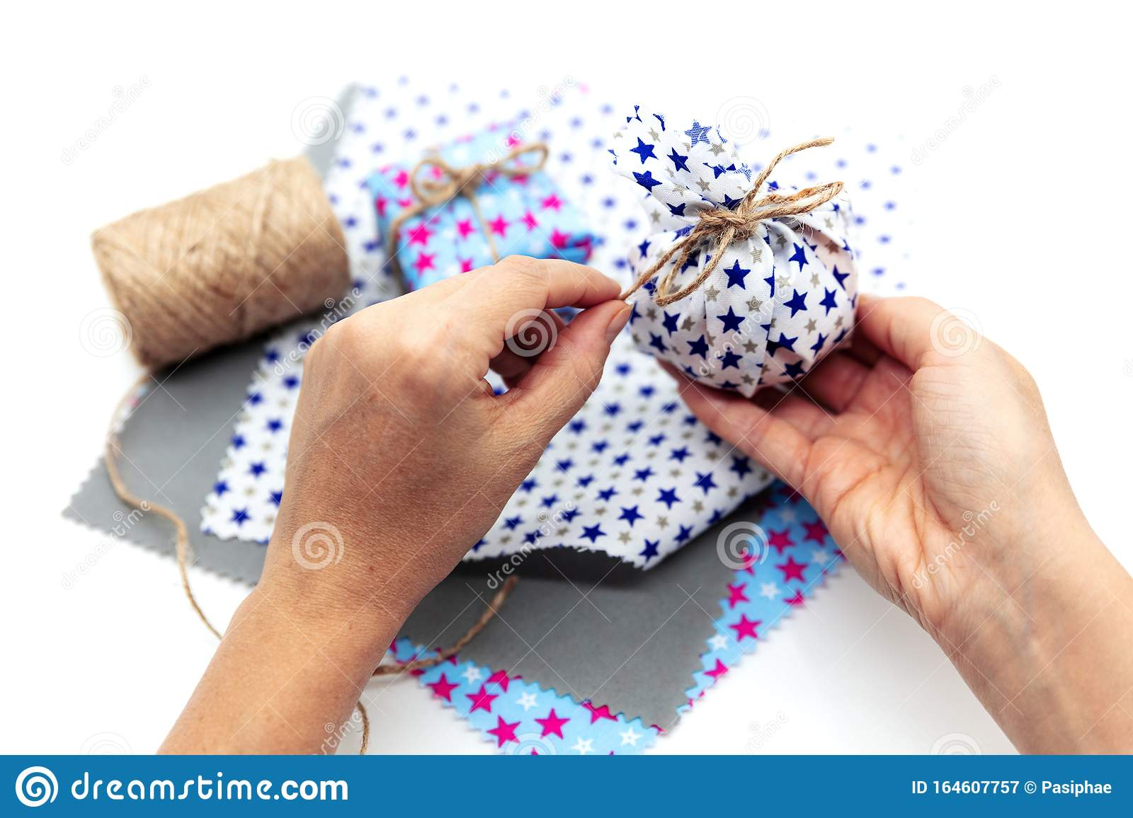 Woman Is Wrapping A Gift With Natural Materials And Organic Cotton Stock  Image - Image of homemade, fabric: 164607757
