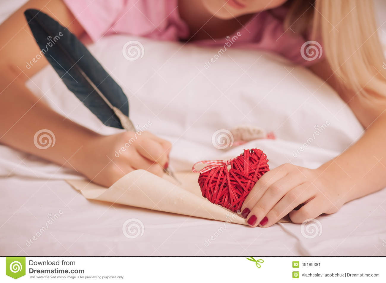 woman writing love letter with feather pen stock image