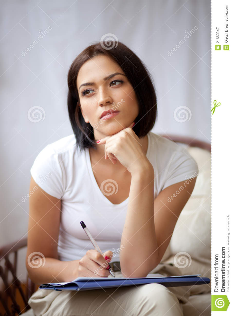 Woman writing on notepad to do list at home