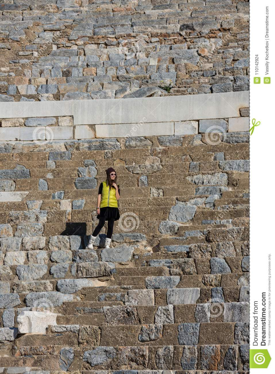 Woman in yellow dress in a sunglasses, Amphitheatre outdoor