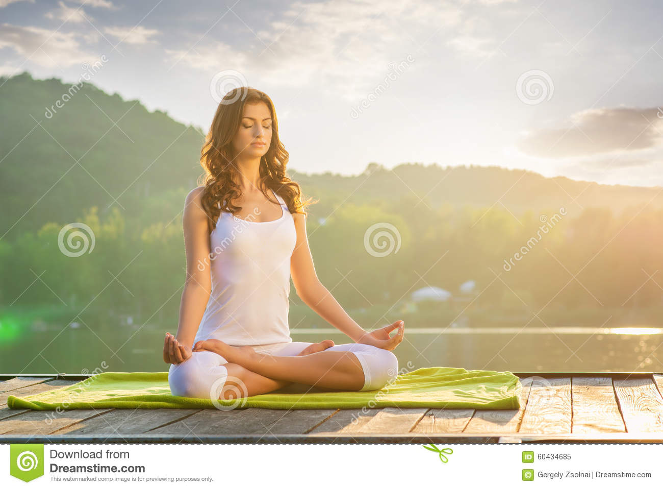 Woman Yoga - relax in nature on the lake
