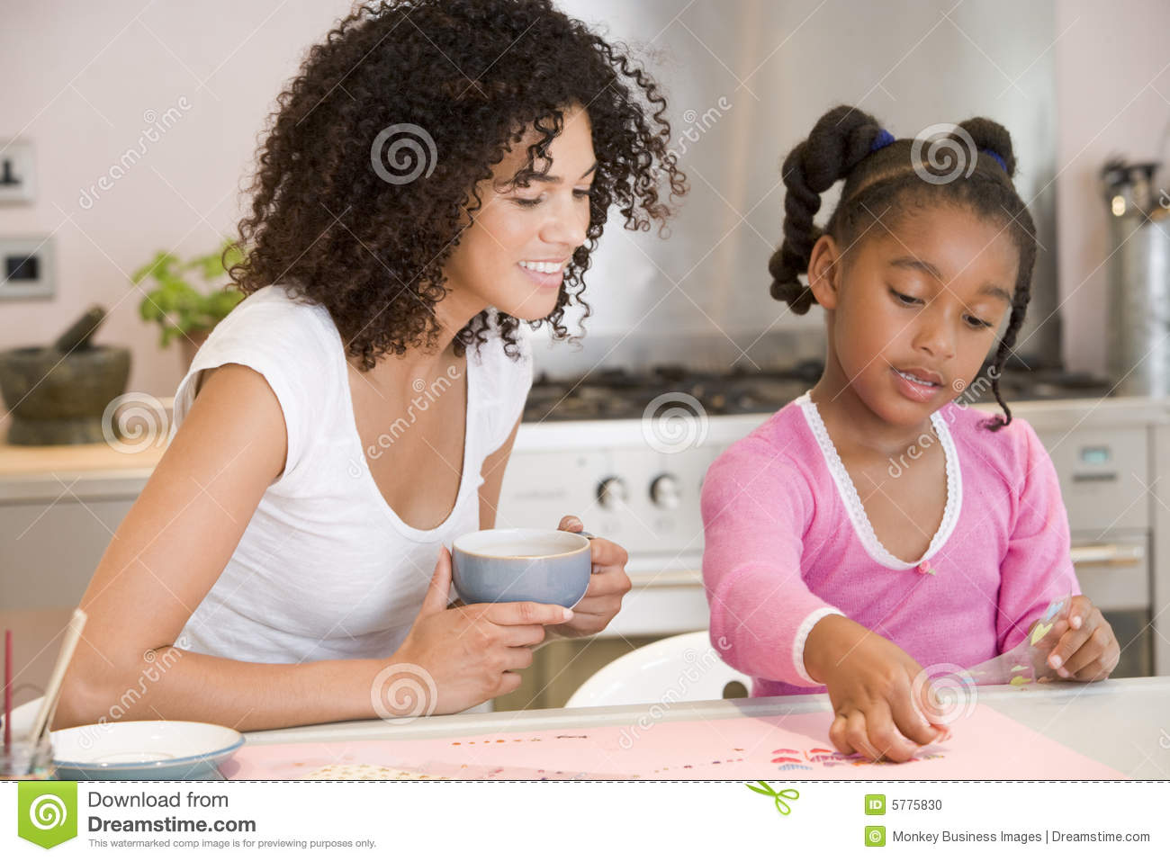 Download Woman And Young Girl In Kitchen With Art Project S Stock Photo - Image of length, horizontal: 5775830