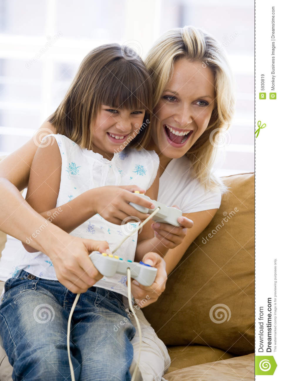Woman and young girl in living room