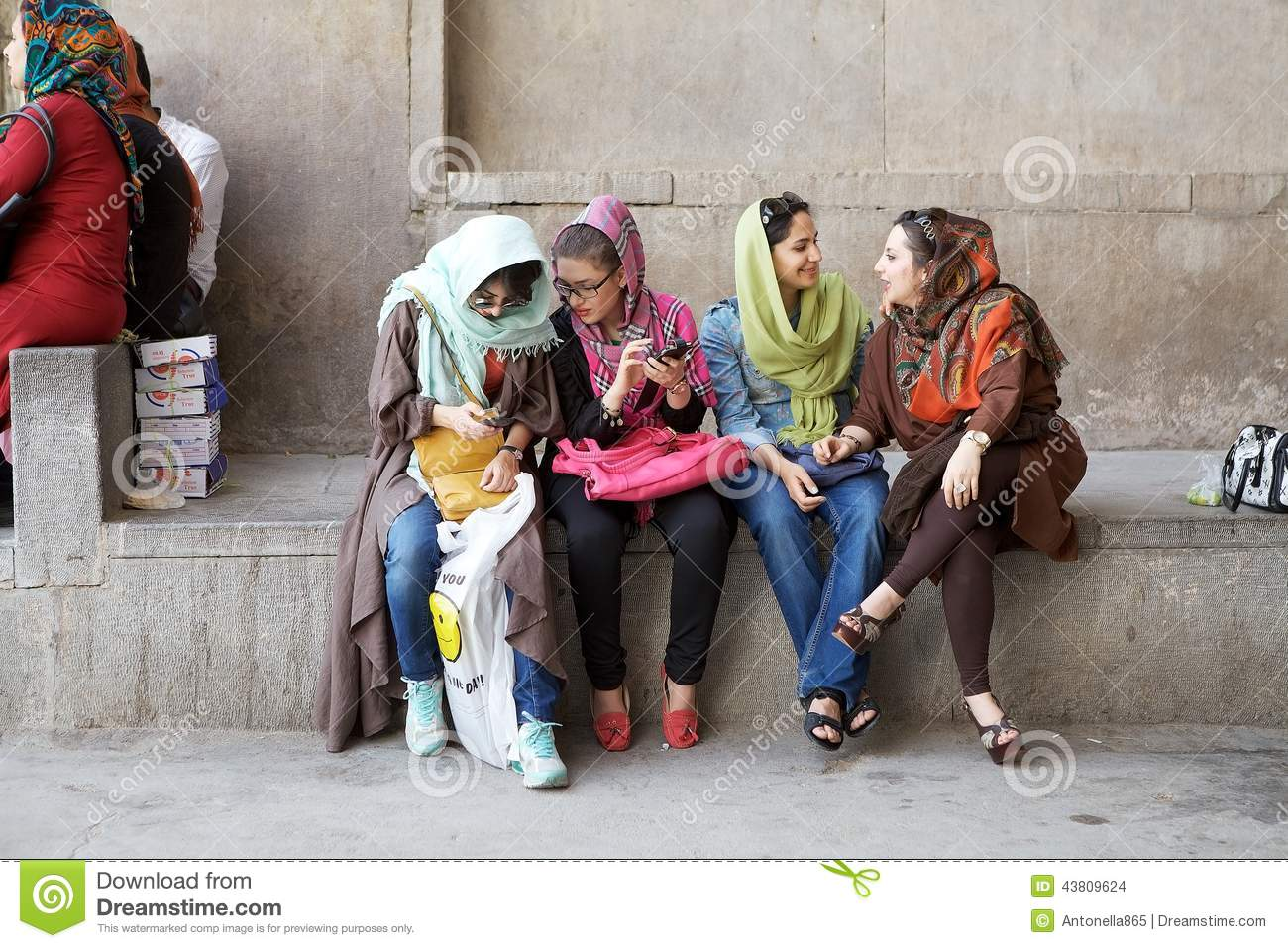 Young iranian women with modern and traditional clothing at the Naqsh