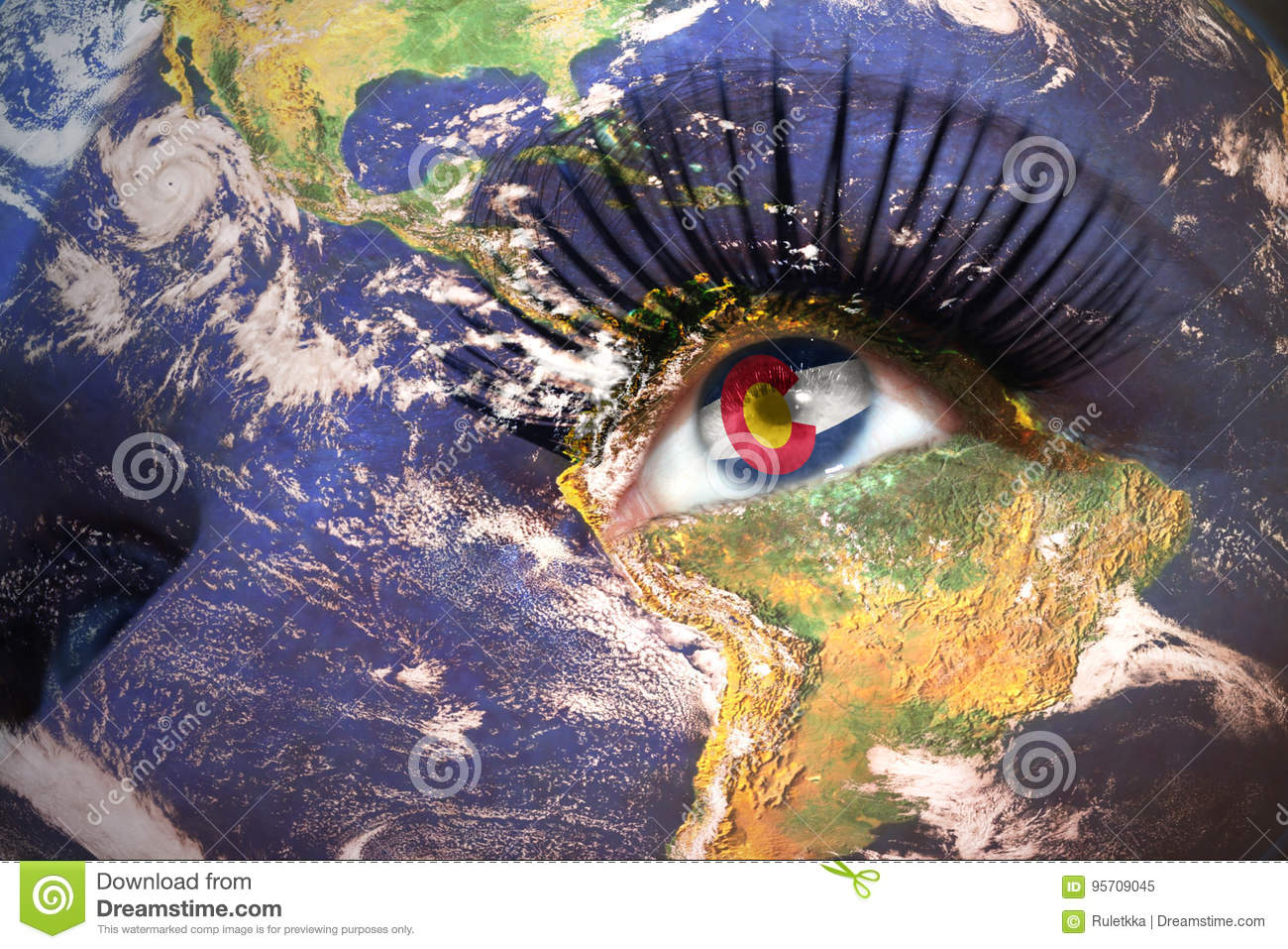 Womans face with planet Earth texture and colorado state flag inside the eye.