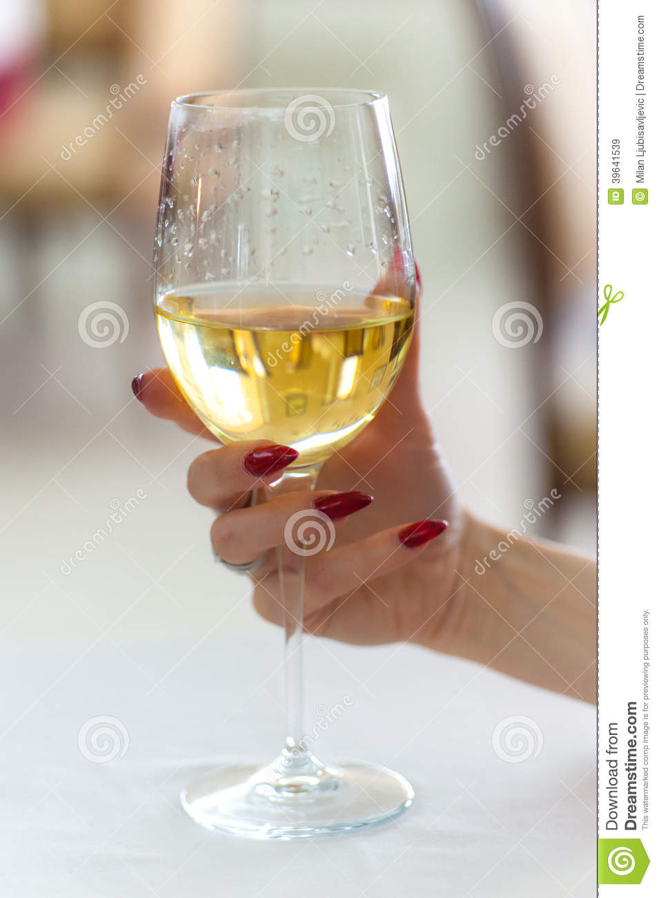 Womans Hand Holding Wine Glass Stock Image - Image: 39641539
