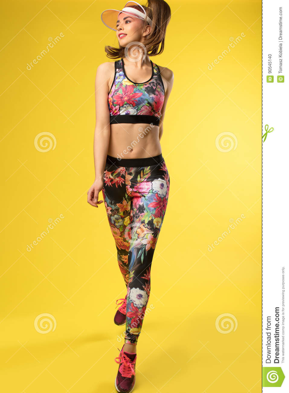 Women with attractive body on the yellow background.