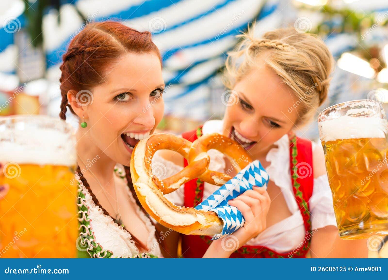 Women with Bavarian dirndl in beer tent