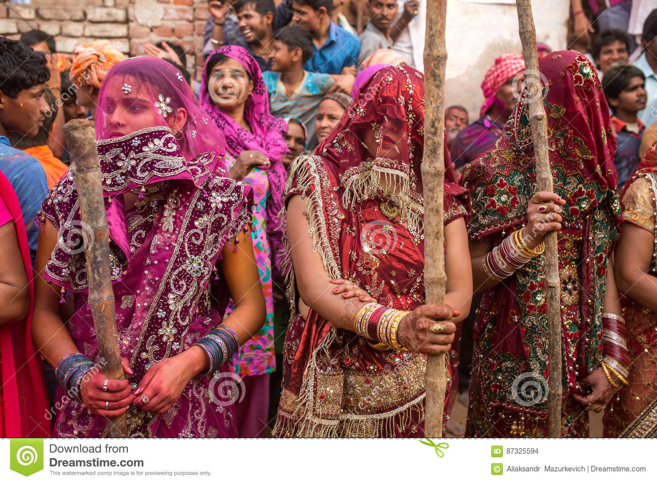 Women beat up men with long sticks as a ritual in the Lathmar Holi celebration in Nandgaon