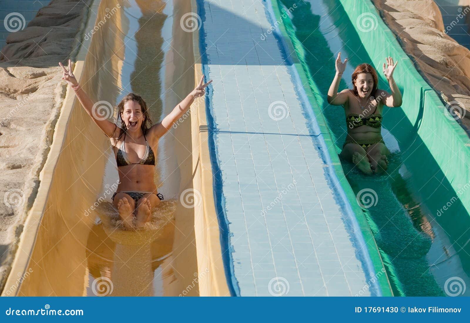 women losing bikini while sliding
