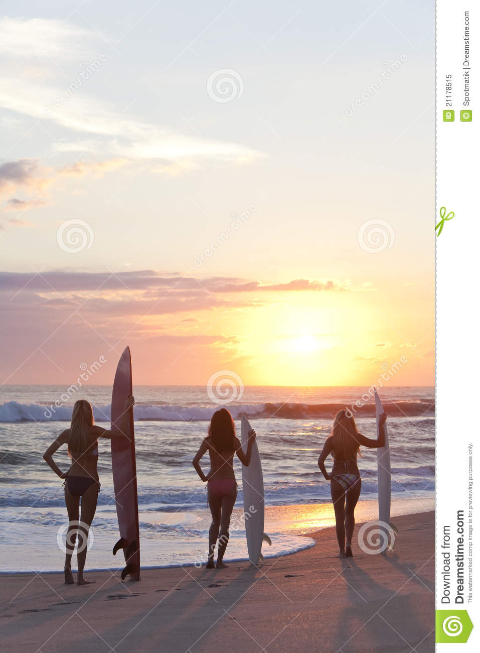 Women In Bikinis With Surfboards At Sunset Beach