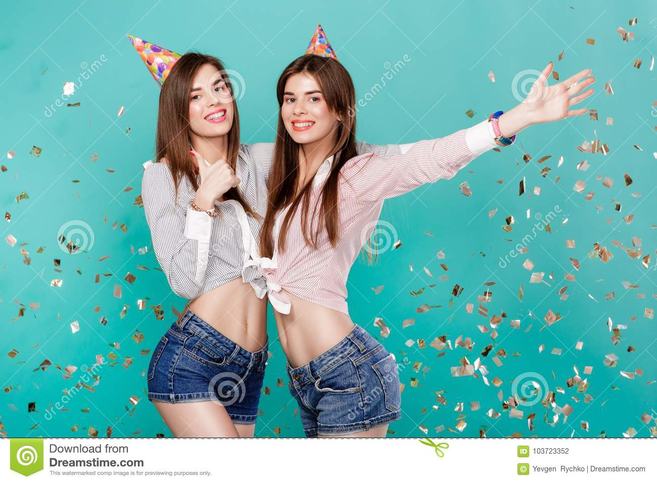 Women in birthday hat and confetti on blue background.