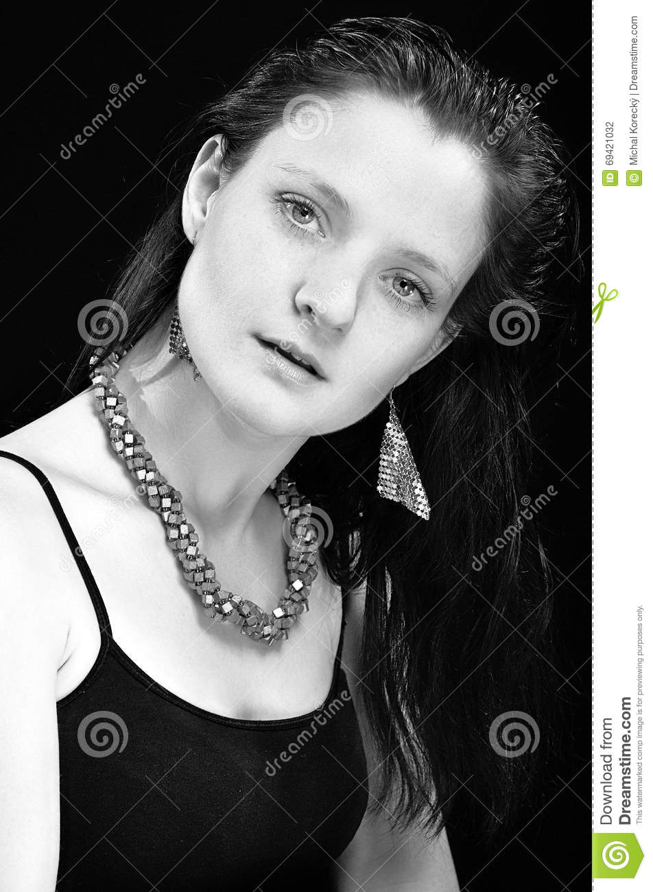 Woman on black and white portraits with necklace and earrings