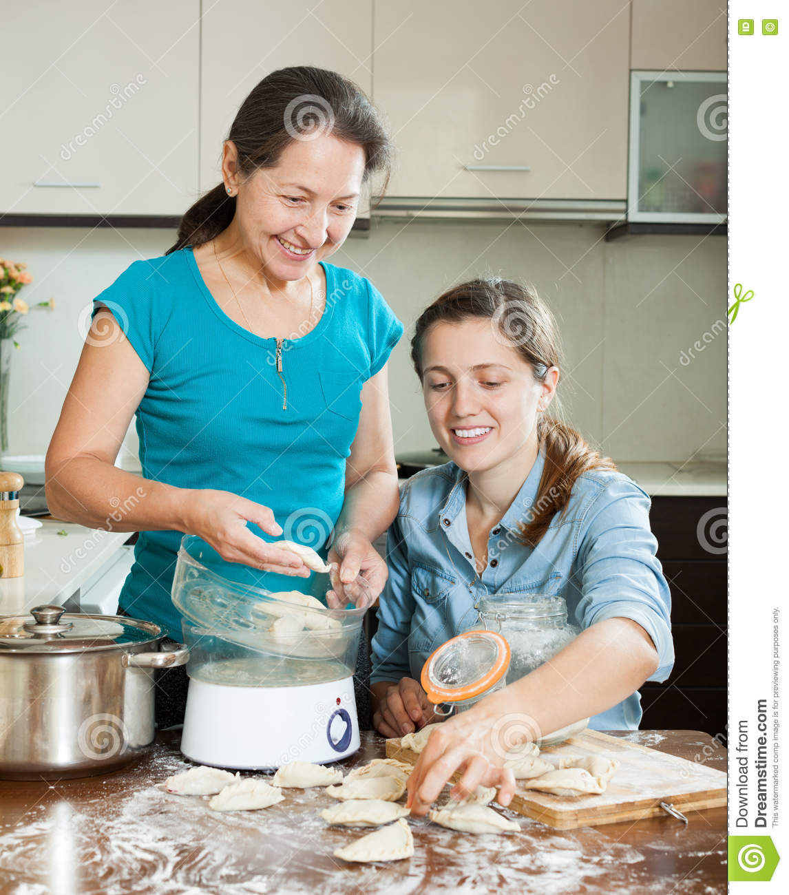 Women Cooking Meat Pasties With Electric Steamer Stock Photo - Image ...