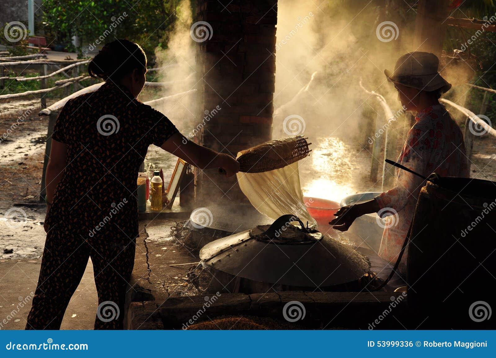 Women Cooking Rice Paste To Make Rice Noodles, Vietnam Editorial Photo  Women Cooking Rice Paste