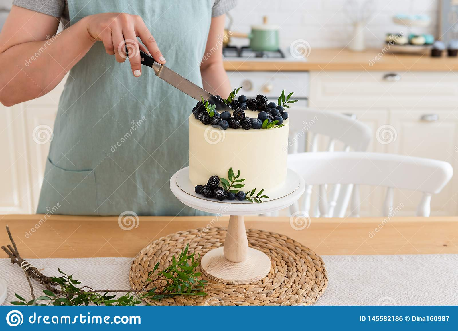 Astounding Women Cutting Birthday Cake With Berries Close Up White Cake Funny Birthday Cards Online Alyptdamsfinfo