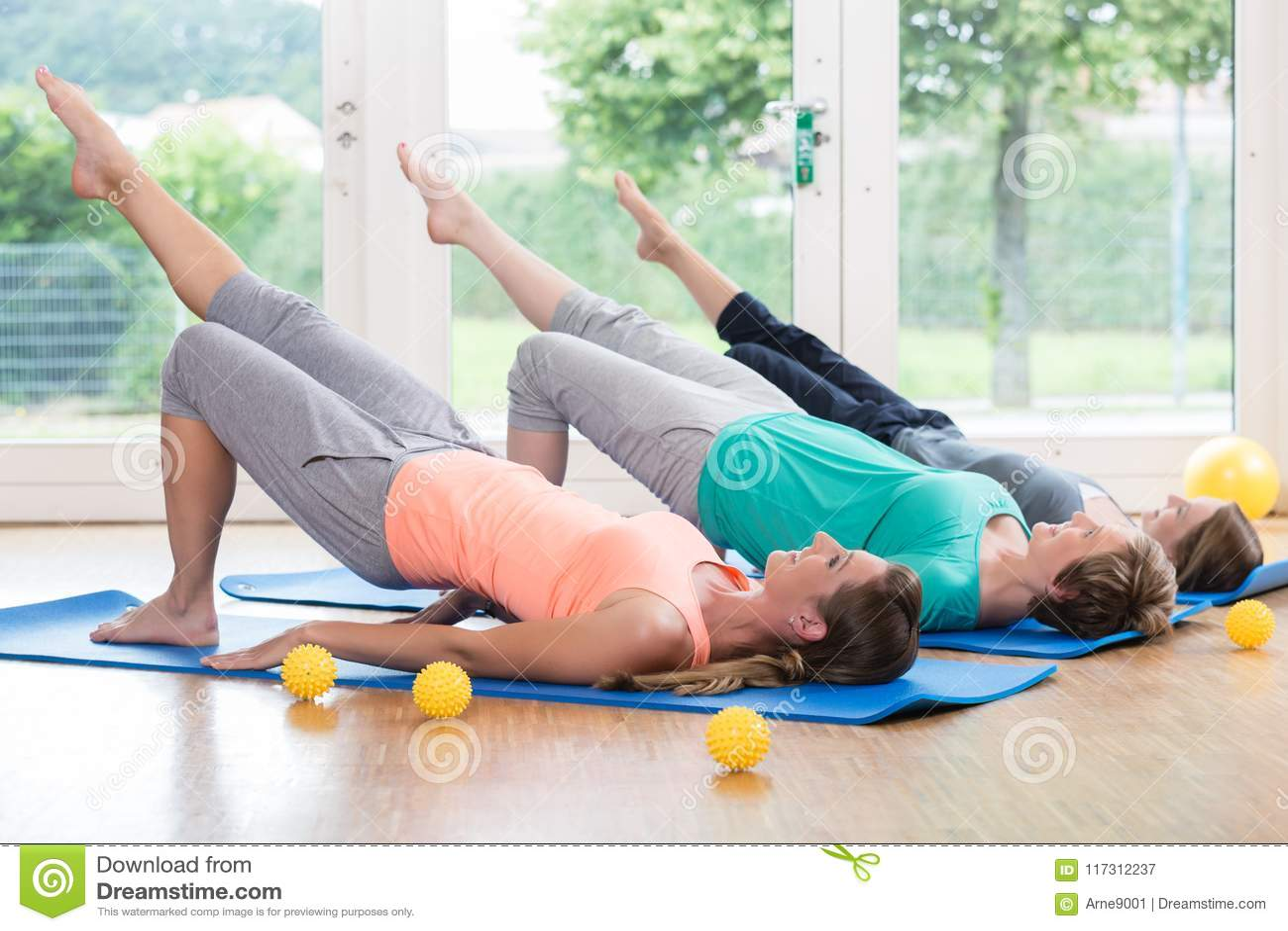 Women doing exercises for pelvis floor in postnatal course