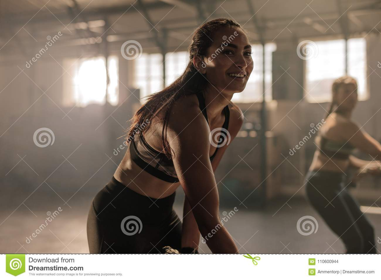 Happy Young Women Doing Intense Physical Workout In Gym Females At Cross Training Class Strength Exercises