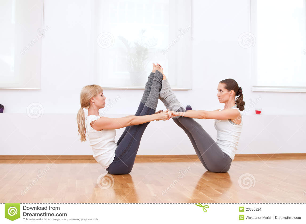 Women Doing Yoga Exercise At Gym Stock Images - Image: 23335324