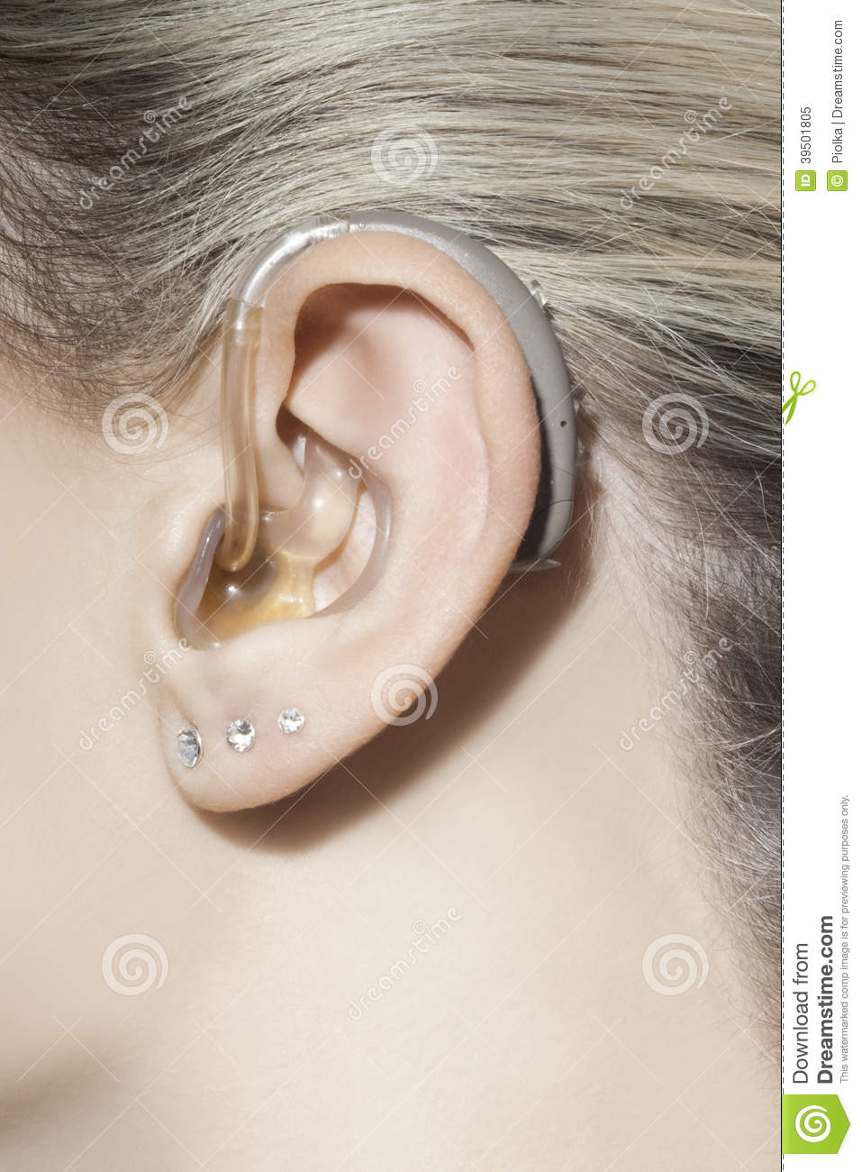 Women ear with hearing aid