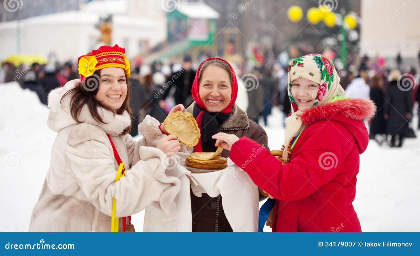 Women eating pancakes during Maslenitsa