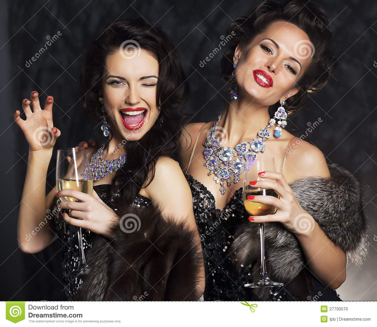 Women in elegant dress with champagne nightlife stock photo image