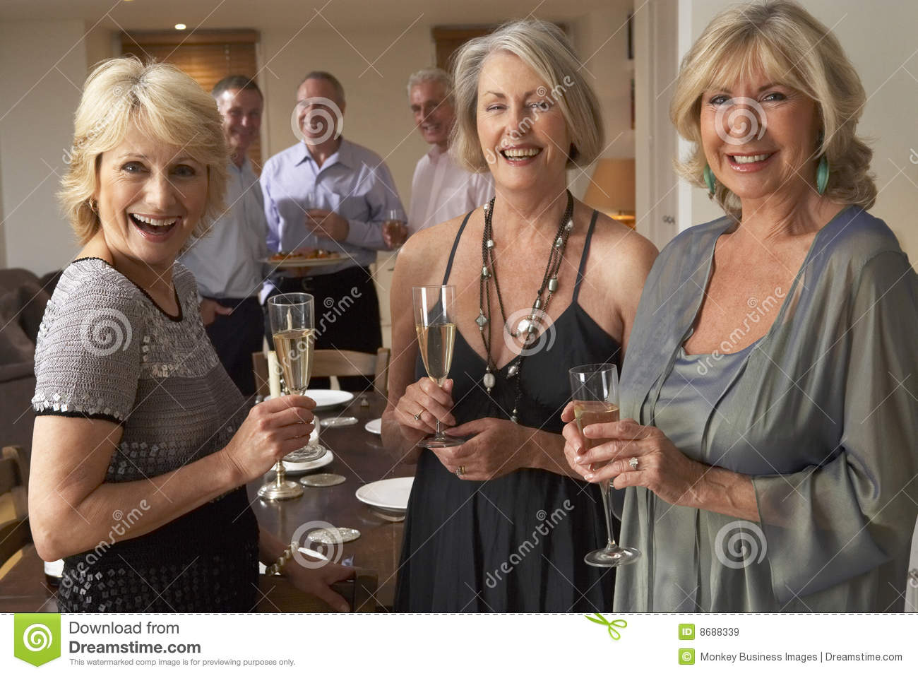 Women Enjoying Champagne At A Dinner Party Royalty Free