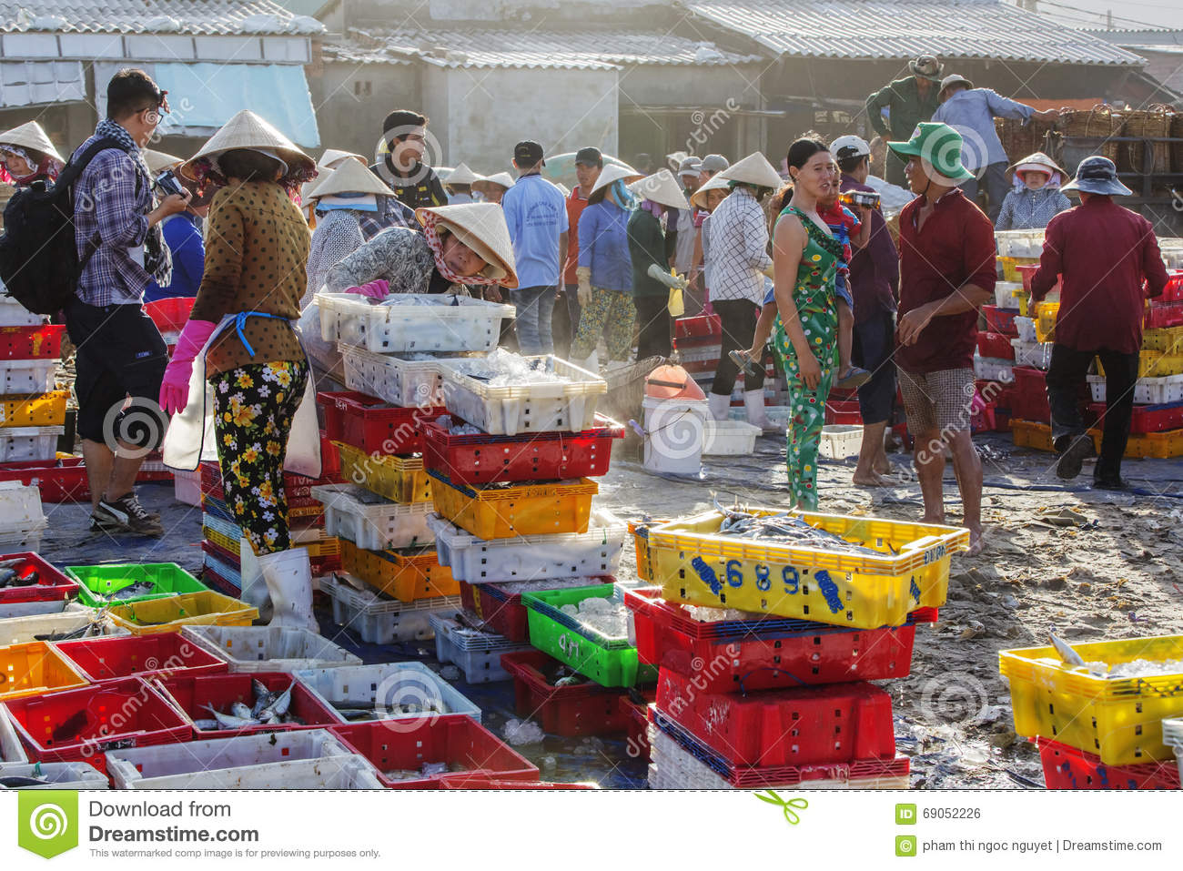 The women are exchanging fish at long hai fish market for Closest fish market