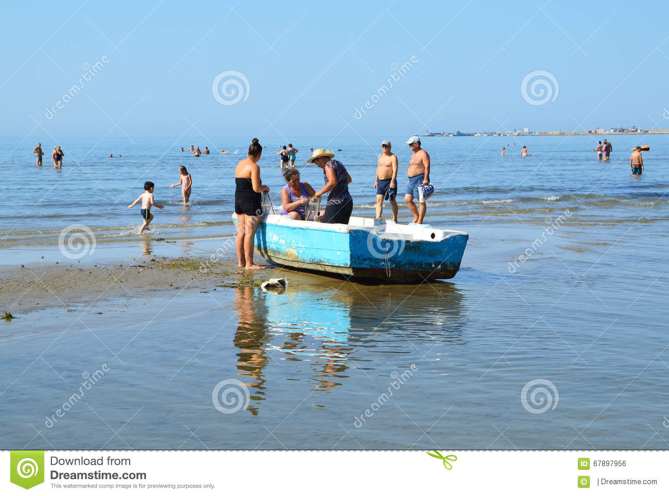 Women in fishing boat on the beach of durres albania for Long beach fishing boat