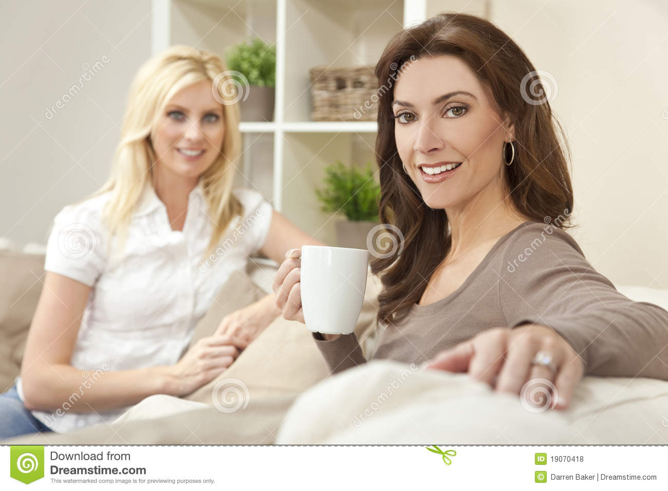 women friends drinking tea or coffee at home royalty free stock photos image 19070418. Black Bedroom Furniture Sets. Home Design Ideas