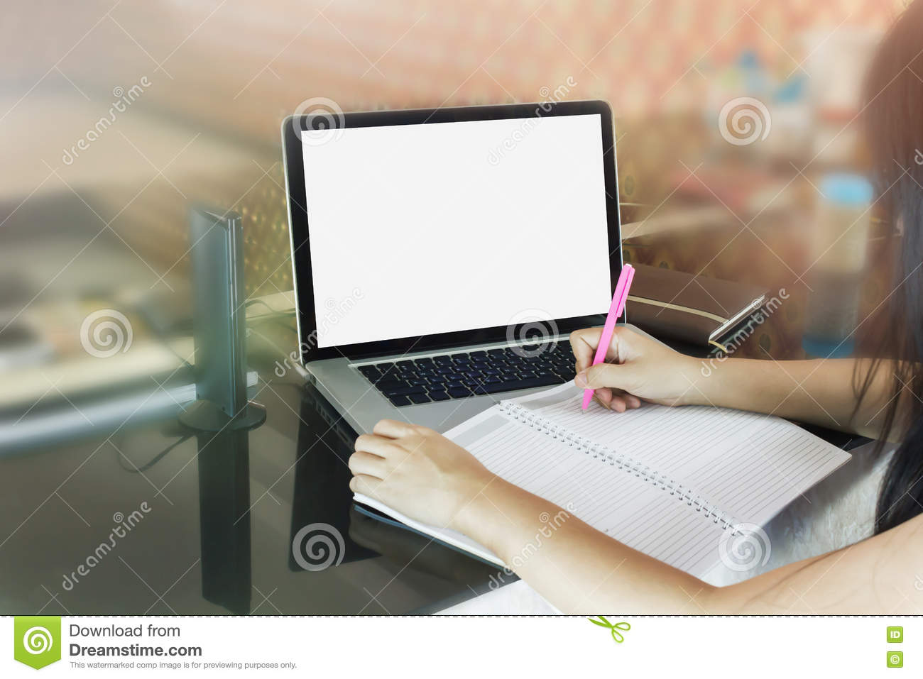 Women or girl writing down on blank note book or making memo on