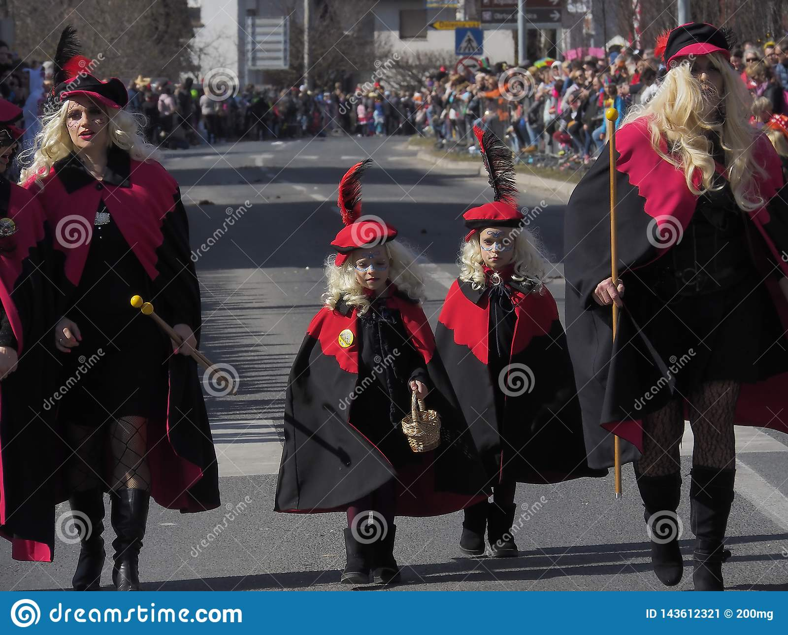 Women and girls in costumes for spring parade