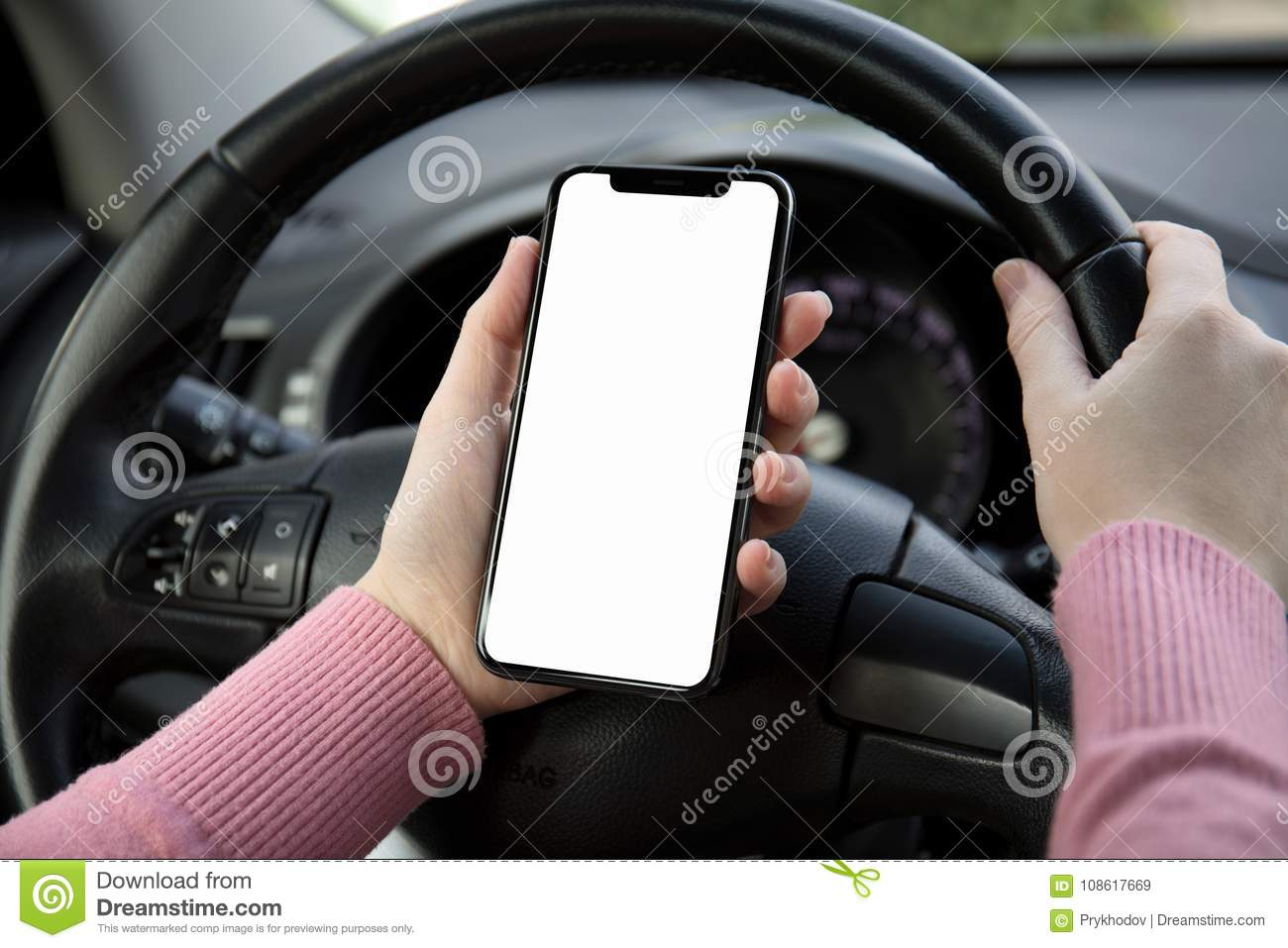 Women hands holding phone with screen in the car