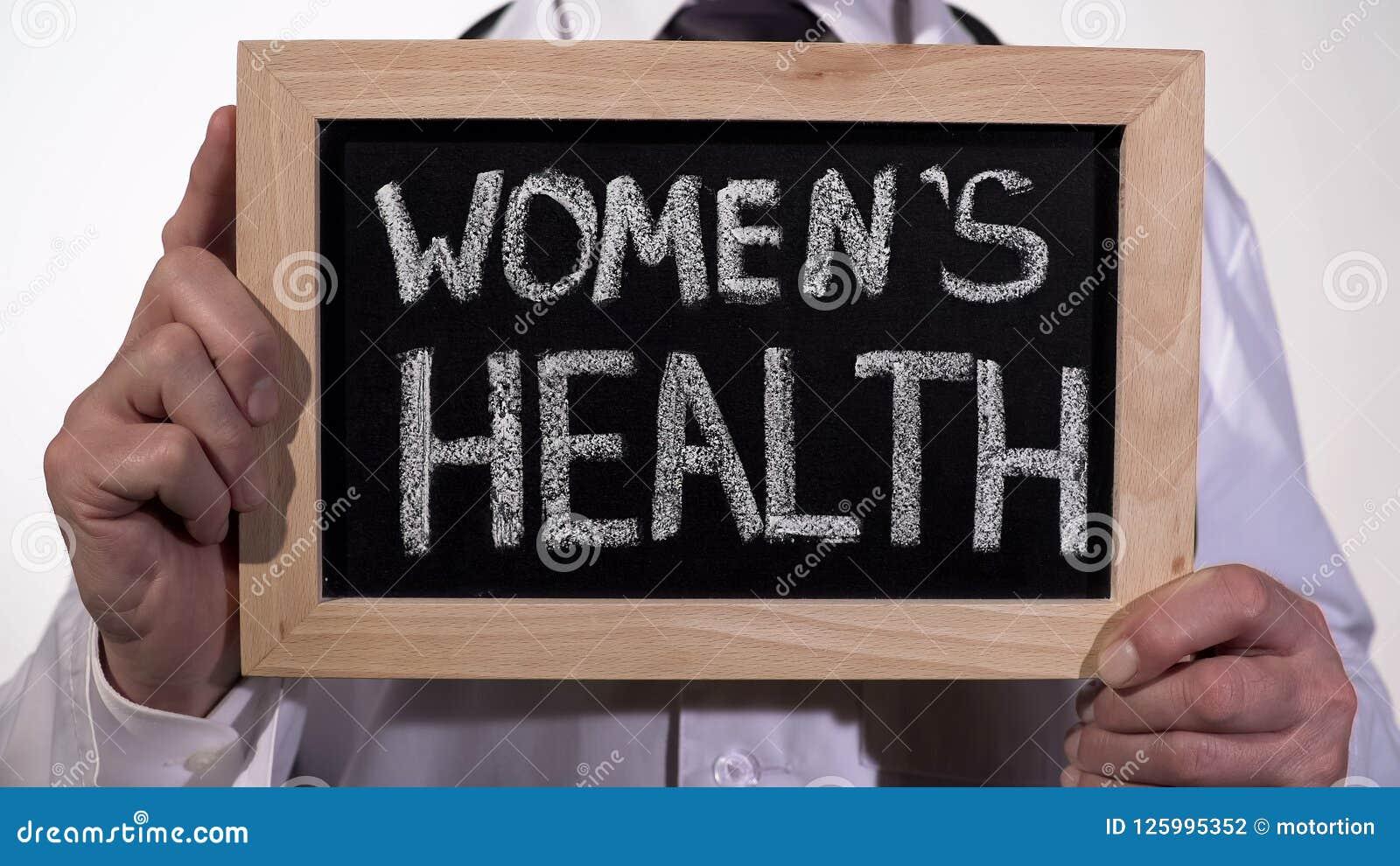 Women health written on blackboard in gynecologist hands, reproductive medicine