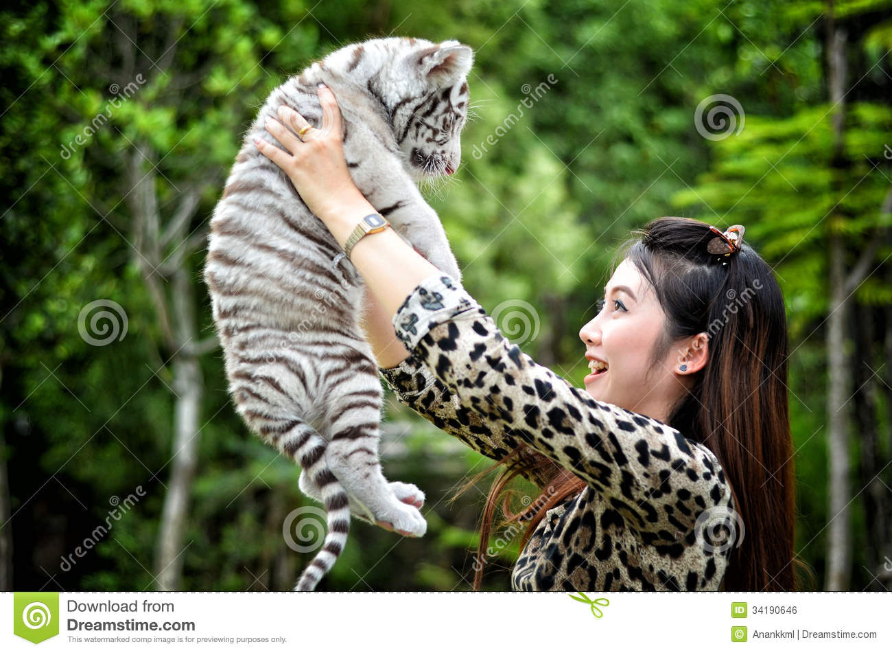 white tiger holding baby - photo #23