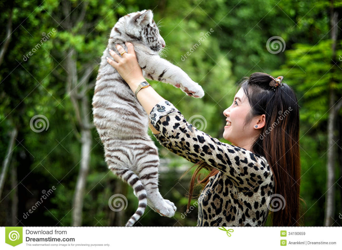 white tiger holding baby - photo #35