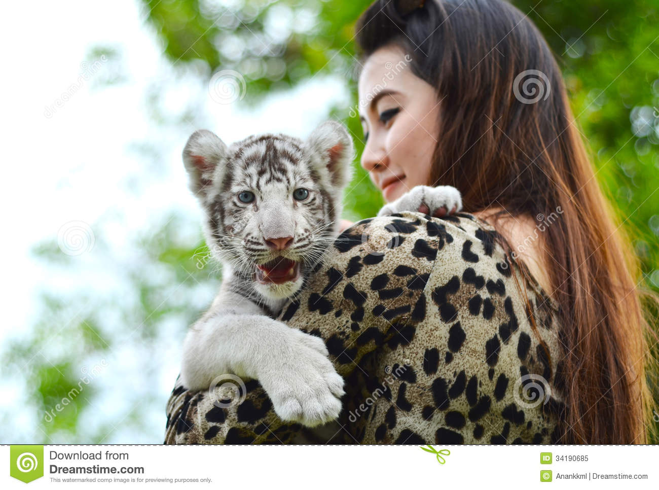 white tiger holding baby - photo #29