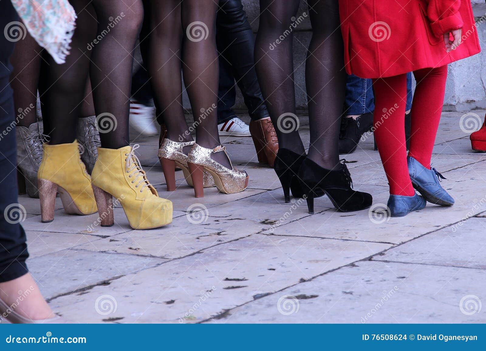 Women legs in a crowd place