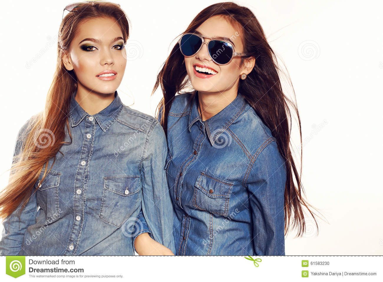 Hair Style Jeans: Women With Long Hair And Bright Makeup Wears Jeans Clothes