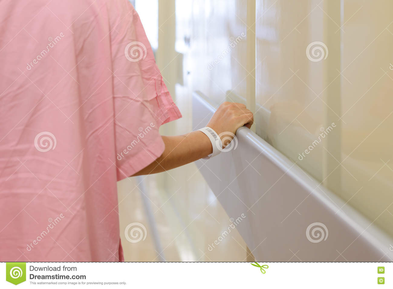 Women patient hand holding to handrail in hospital