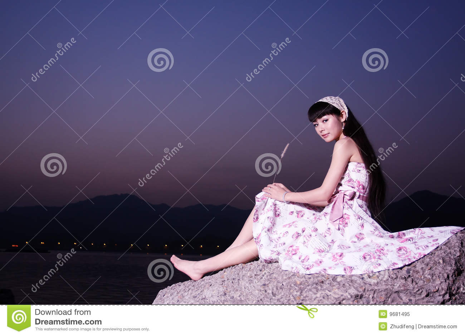 Women relax on rock