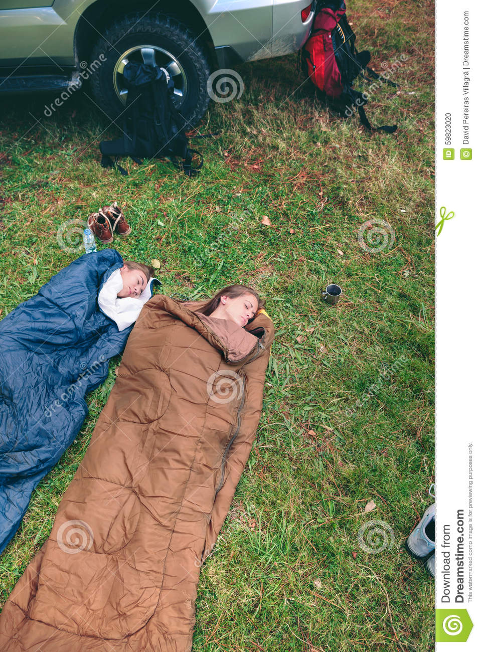 Women Resting Inside Of Sleeping Bags With 4x4 On Stock