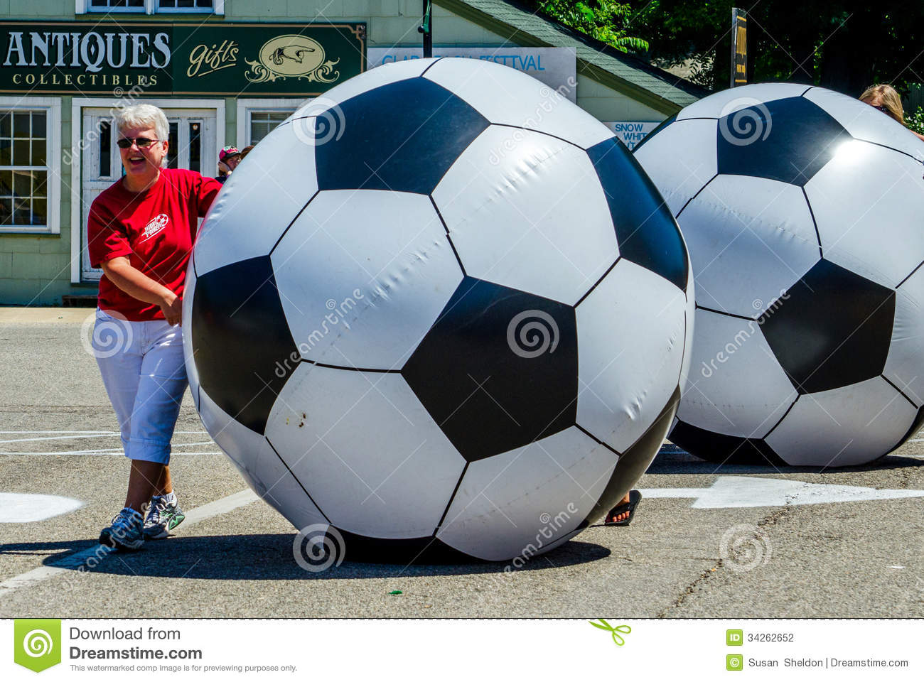 Women Rolling Giant Soccer Balls Editorial Photography ... Rolling Soccer Ball