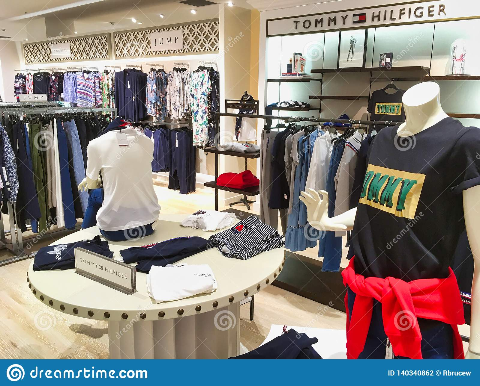 184ccc68 Racks of women`s clothes in large modern department store or shop, Sydney,  Australia. Tommy Hilfiger designer clothes.