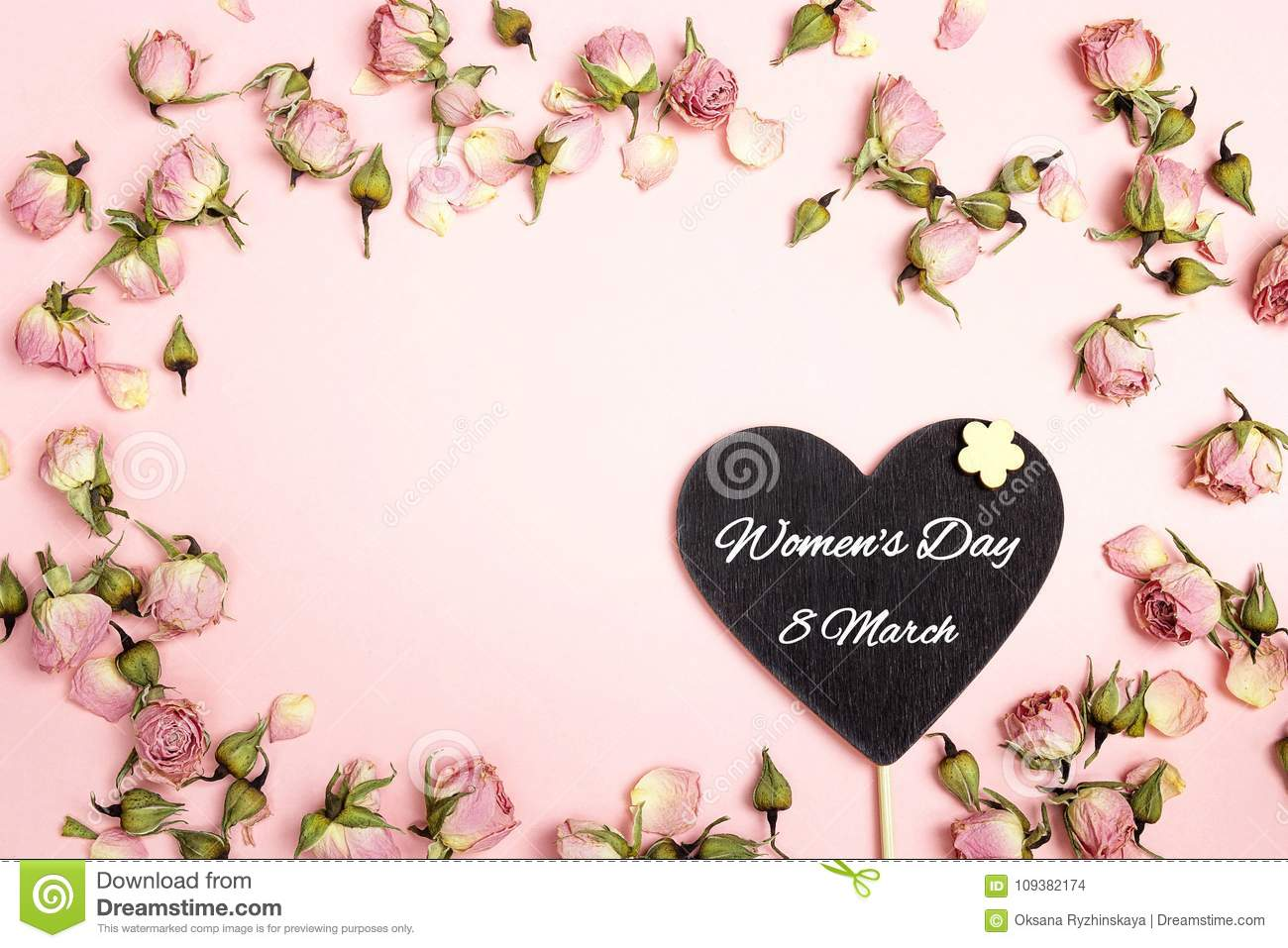 Women`s Day greeting message on heart-blackboard with small dry