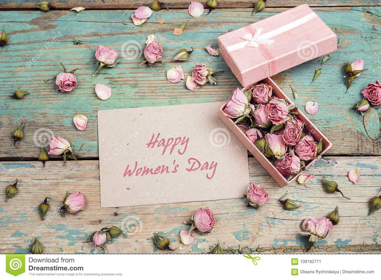 Women`s Day greeting message with little pink roses in a box on