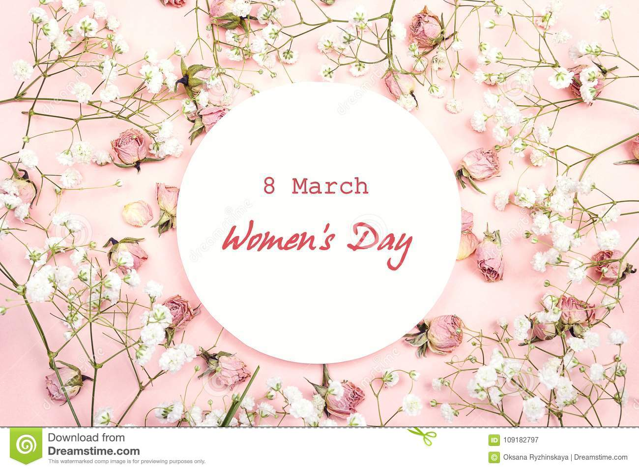 Women`s Day greeting message on white round frame with gypsophil