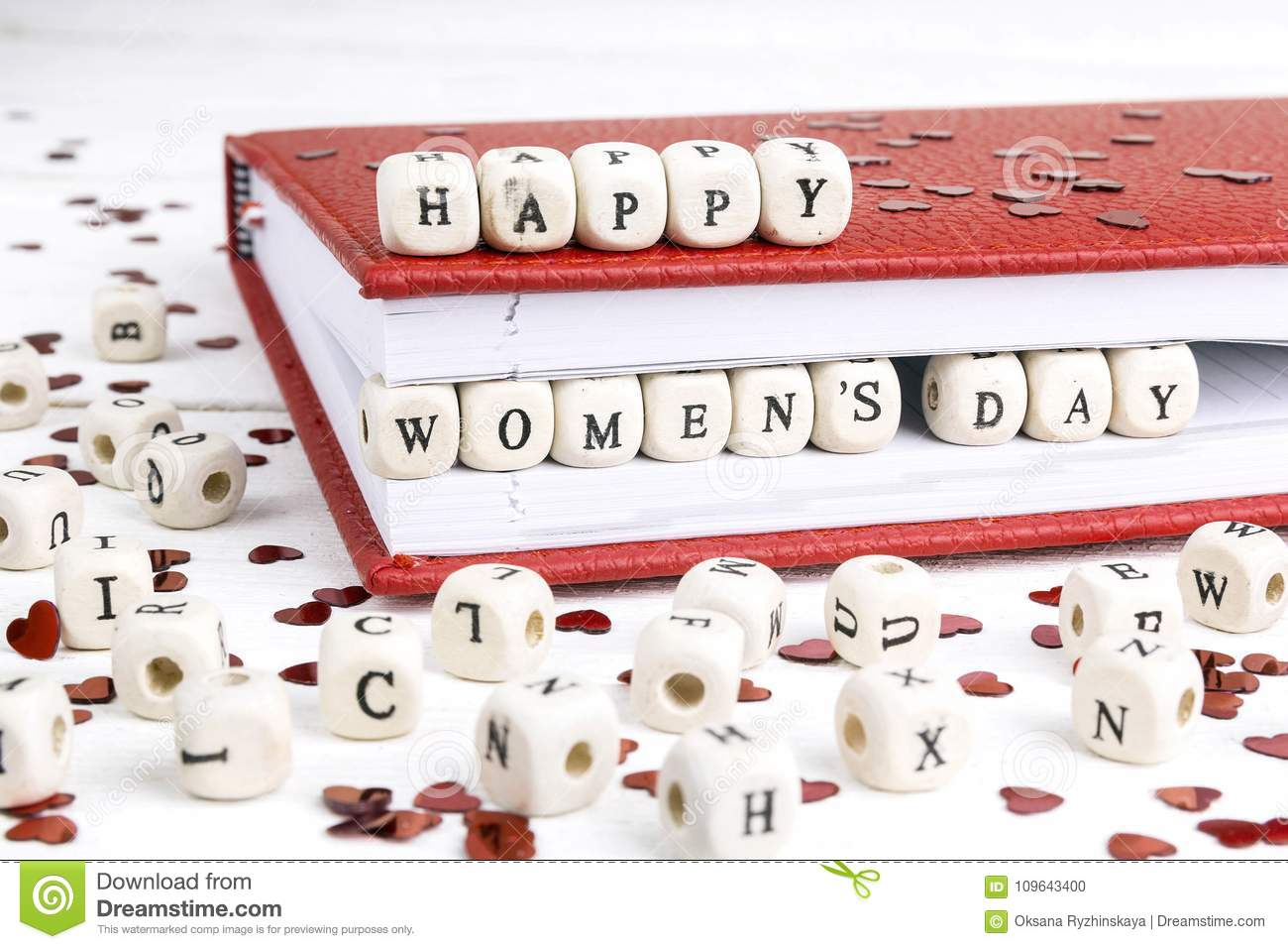 Women`s Day greeting message written in wooden blocks in red not
