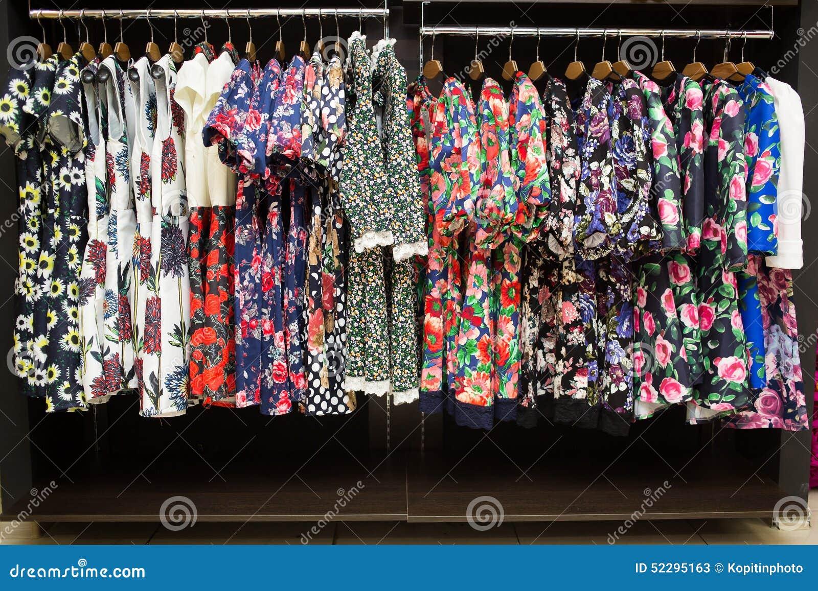 Women s dresses on hangers in a retail shop