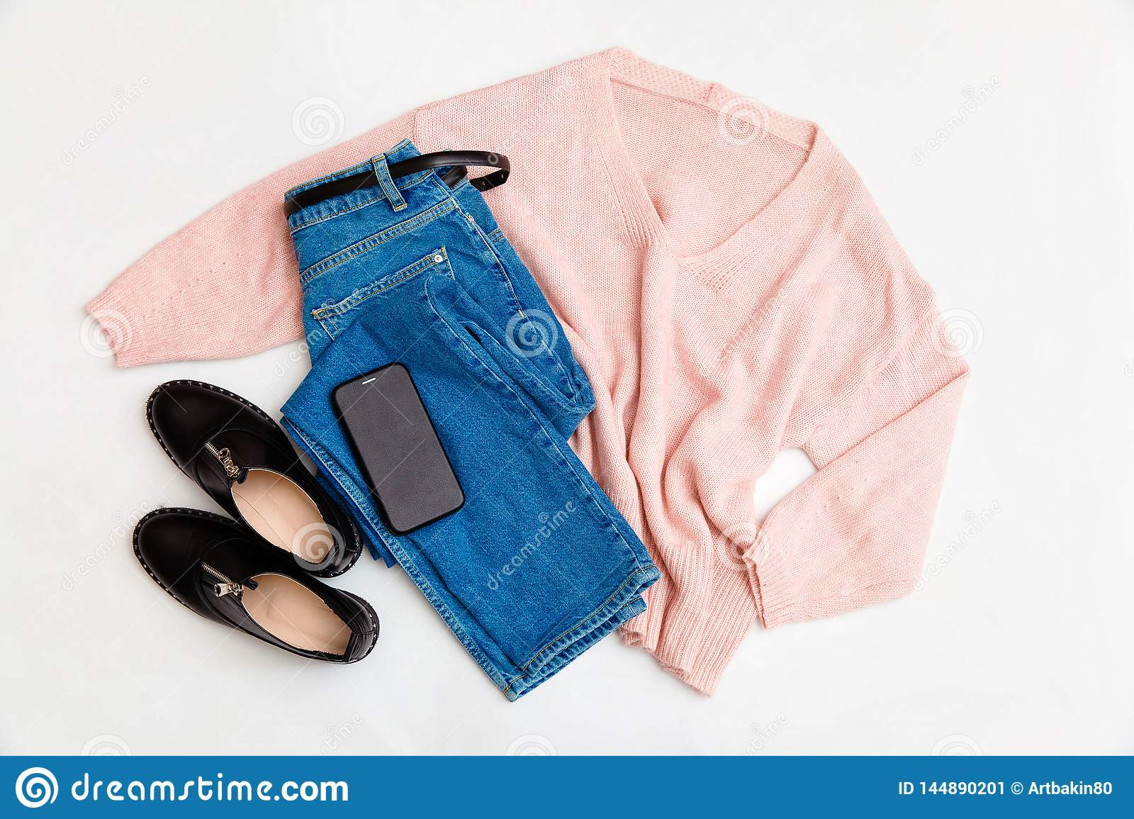 acf235a99fd6 Women`s fashion clothing and accessories. Female youth collage on white  background top view. A flat lay-out in feminine style looks with a warm  sweater, ...
